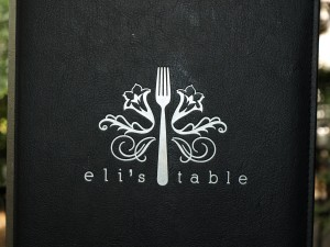"The cover of the menu with the ""fork-de-lis"", it is so cute!"