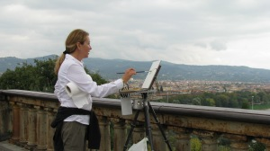 Laura trying to paint something before it rained.